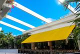 Retractable awning roof, partially retracted
